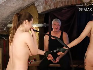 beautiful girl cries as her sister whips her