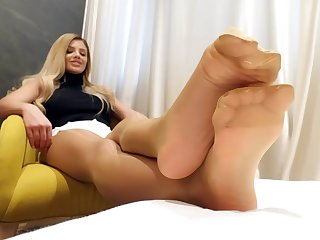 blonde shows her feet in pantyhose